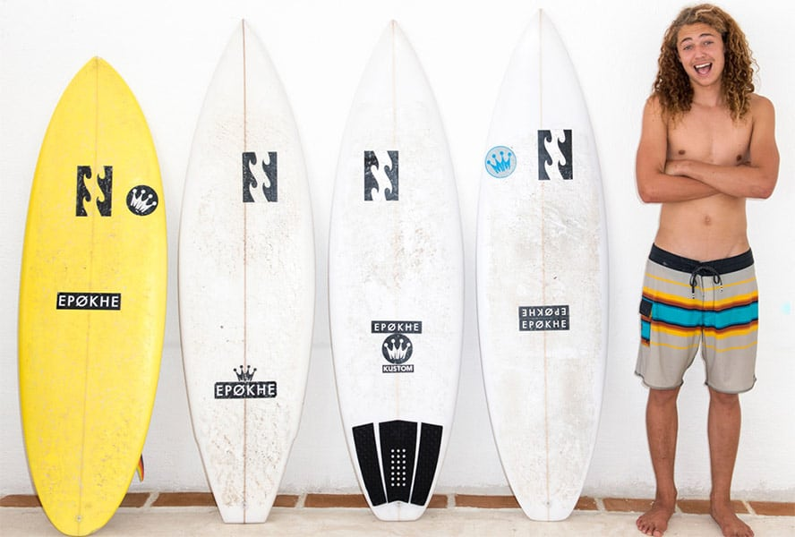surfclub-surfboy-with-boards2